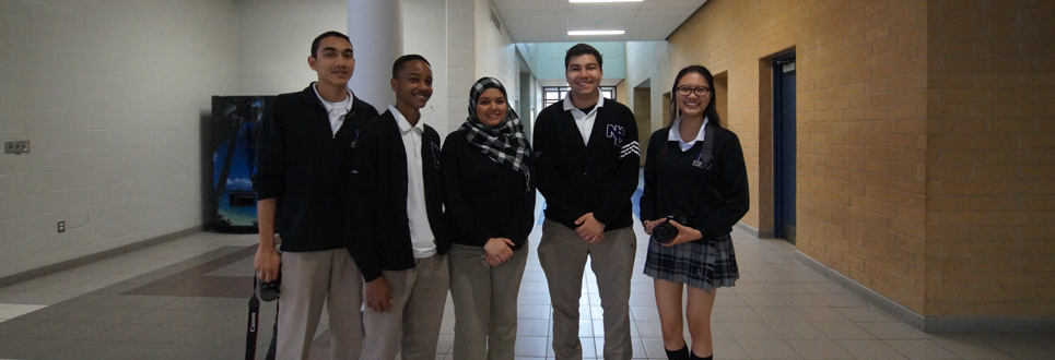 Three male and two female students wearing their school uniforms